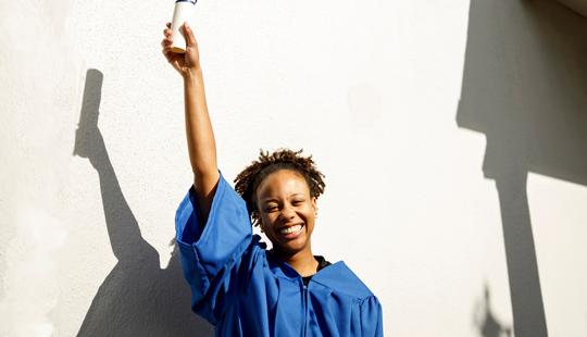 graduate woman smiling