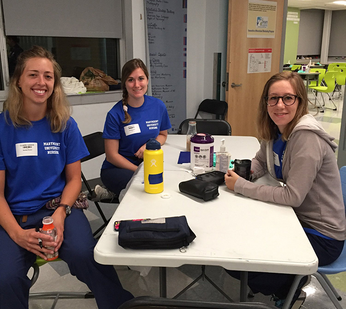 Nursing students, faculty put knowledge and skills to the test at Remote Area Medical clinic in Baltimore
